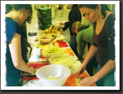 Preparing cold meal packs for the homeless - busy workers